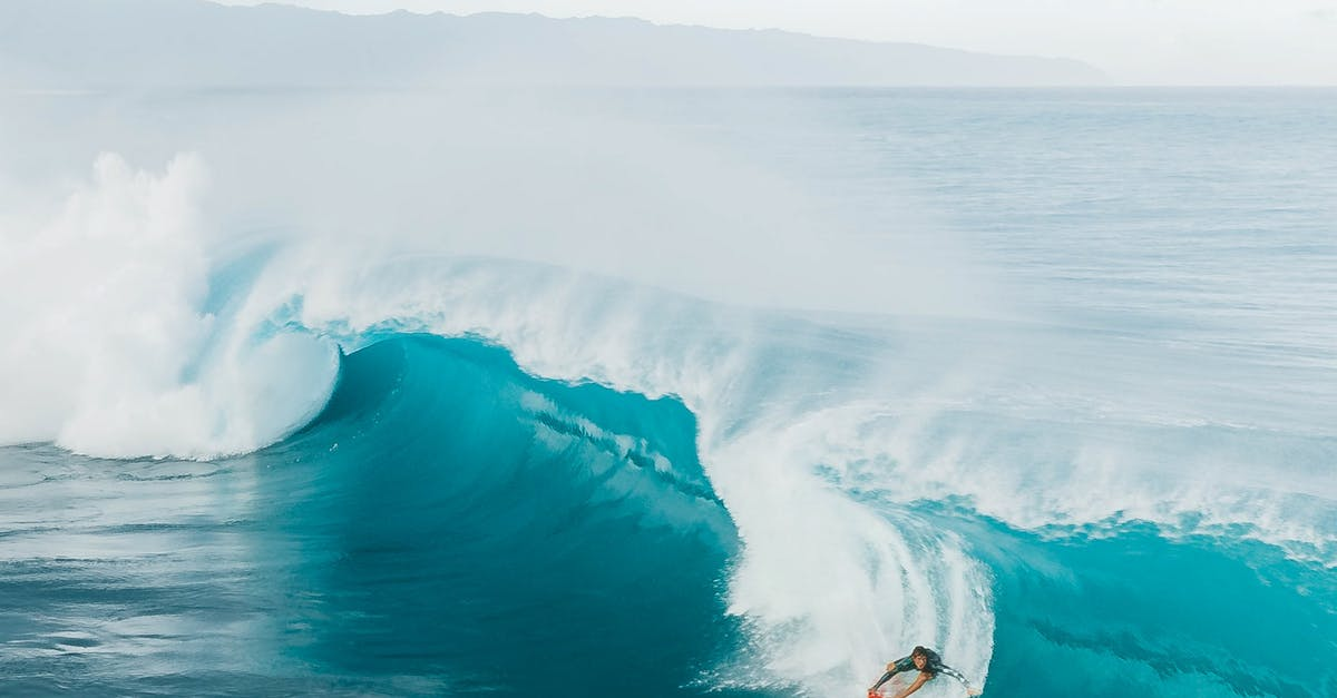 A man riding a wave on top of a body of water